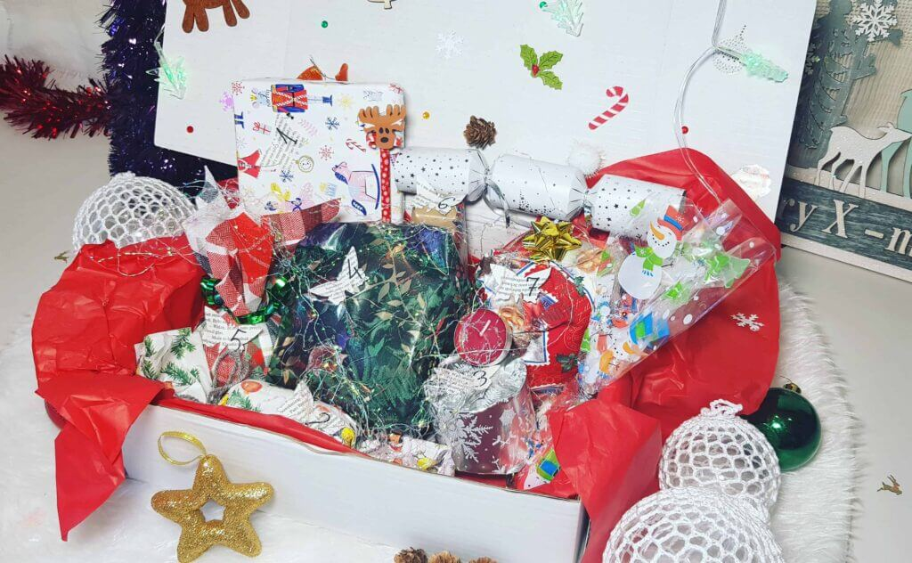 gifts with candles, sweets and christmas decoration